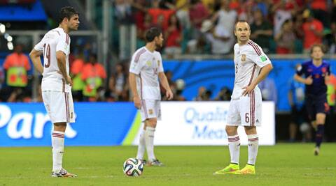 Spain's Diego Costa, left, and Andres Iniesta react during their World Cup opener against the Netherlands. They were crushed 5-1 by the Dutchmen. (Source: AP)