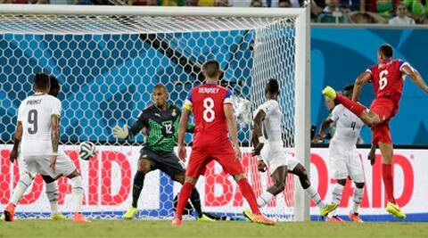 United States' John Brooks, right, scores his side's second goal during the group G World Cup soccer match between Ghana and the United States. ( Source: AP Photo )