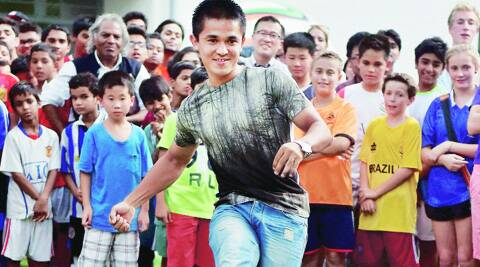 Indian captain Sunil Chhetri kicks a ball during launch of an ebook on World cup Football at the German embassy in New Delhi on Monday. (Source: PTI)