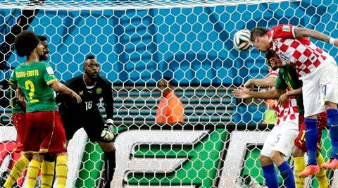 Croatia's Mario Mandzukic, right, scores his side's third goal during the group A World Cup soccer match between Cameroon and Croatia at the Arena da Amazonia in Manaus. ( Source: AP )