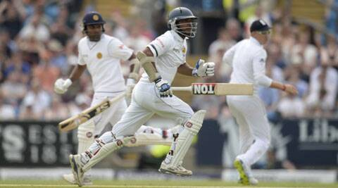 Kumar Sangakkara (C), who became the fourth player to score seven consecutive Test half centuries, shared a 79-wicket third-wicket partnership with Mahela Jayawardene (L). (Source: Reuters)