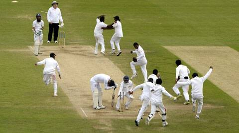 England's James Anderson looks down as Sri Lanka celebrate winning the second Test (Source: Reuters)