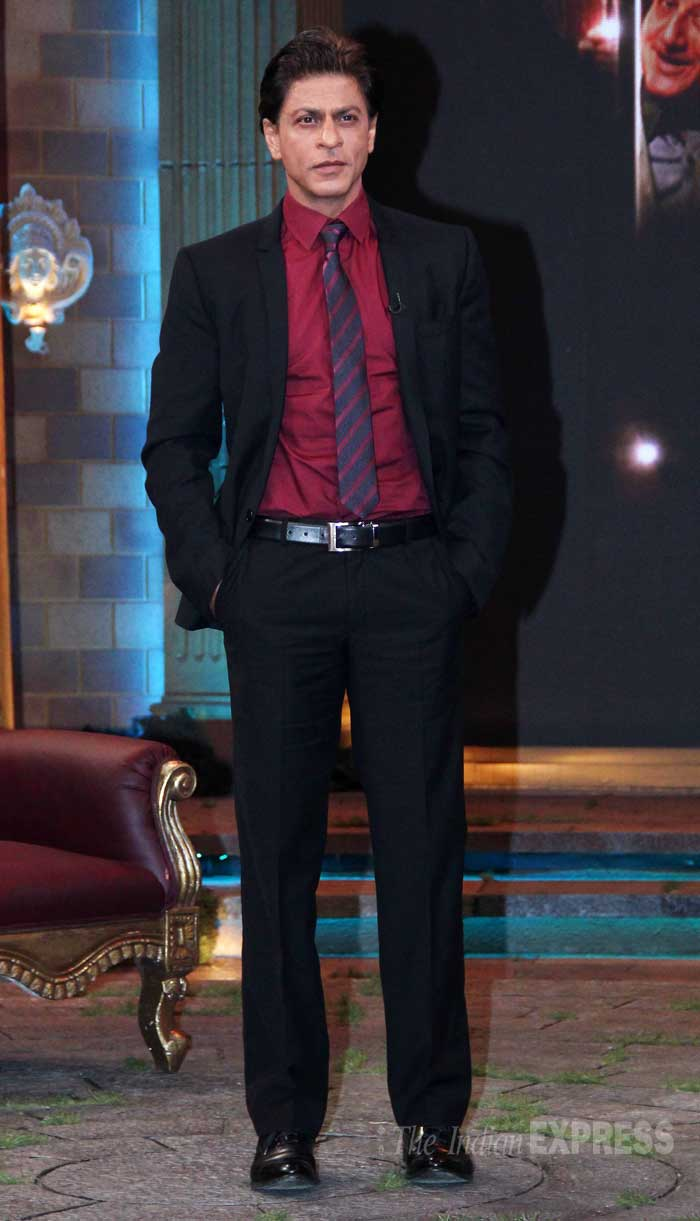 Shah Rukh Khan was dapper in a black suit with a berry coloured shirt and striped tie. (Source: Varinder Chawla)