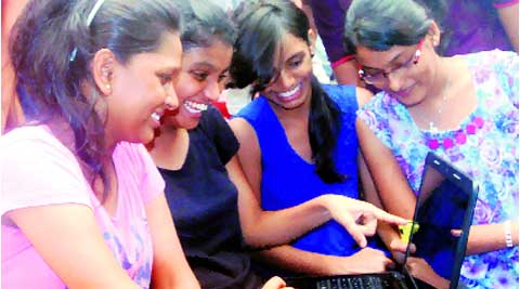 Students check their results online in Thane.  (Source: Express photo by Deepak Joshi)