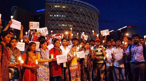 IT professionals & students take part in a candle light march for the 24 engineering students who were swept away in Beas River in Himachal Pradesh. (Source: PTI)