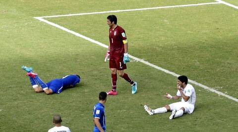 From Champ to Vamp: The Uruguayan striker faces a risk of being banned for up to 24 months and may miss the rest of the World Cup. Many senior football observers and ex players have condemned the incident and believe he should have gotten sent off. (Source: AP)