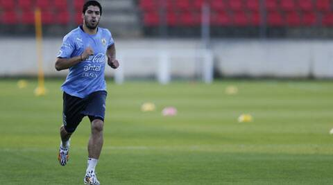 Luis Suarez runs during a training session at Jacare Stadium in Brazil on Tuesday. (Source: AP)