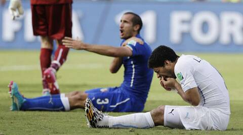 Suarez was banned for nine matches and four months from all football. (Source: AP)