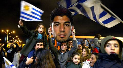 When Suarez flew home on Friday, he was met by outraged President Jose Mujica at a military base next to Uruguay's main airport. (AP)