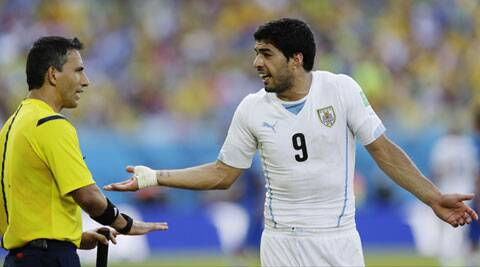 Luis Suarez was banned for 10 games last year after biting Chelsea's Branislav Ivanovic (Source: AP)