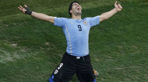 Luis Suarez celebrates scoring his team's second goal against England during their Group D match in Sao Paulo on Thursday. (Source: Reuters)