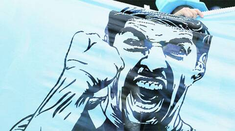 Uruguay fans unfurl a poster of Luis Suarez with his unmistakable teeth (Source: Reuters)
