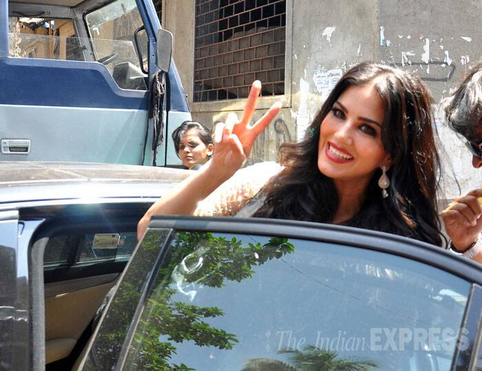 Sunny Leone gives us a big smile before taking off in her car. (Source: Varinder Chawla)