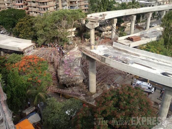 At least two labourers were killed and six were seriously injured after an under construction over bridge collapsed in Athvalines area in Surat.  (Source: Express photo)