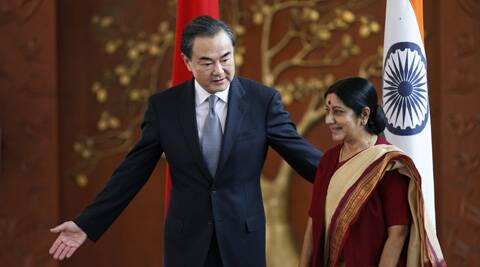 Indian External Affairs Minister Sushma Swaraj, right, and her Chinese counterpart, Wang Yi, leave for a meeting after a photo session in New Delhi, India. (AP)