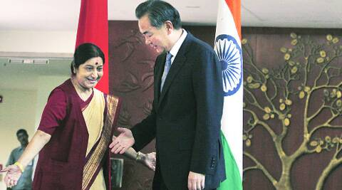 Chinese Foreign Minister Wang Yi with his Indian counterpart Sushma Swaraj in the capital on Sunday. (Source: Express photo)