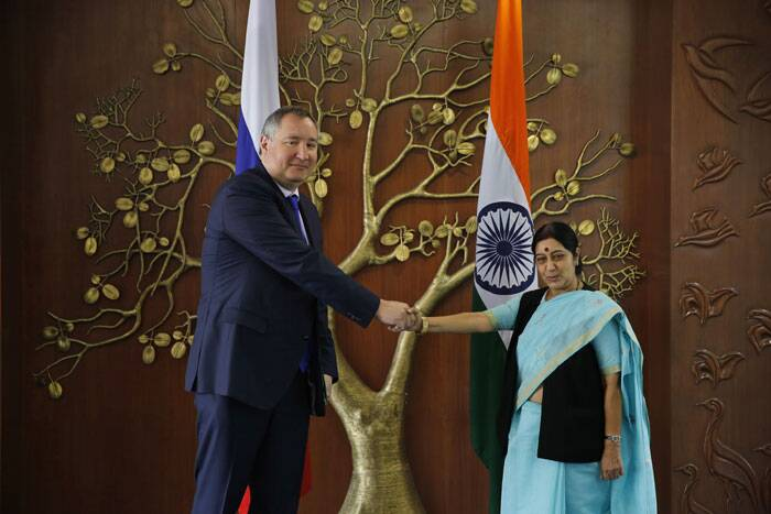 Both Sushma Swaraj and Dmitry O Rogozin, who arrived in the capital early on Wednesday on a two-day visit, are understood to have discussed about preparations for the annual Summit between Prime Minister Narendra Modi and President Putin scheduled during the course of the year. <br /> Dmitry Rogozin, left, and Sushma Swaraj, pose for the media before their meeting in New Delhi. (Source: PTI)