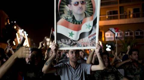 Syrian soldiers celebrate Bashar Assad's presidential re-election in Damascus, Syria. (Source: AP)