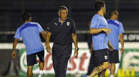 Uruguay's head coach Oscar Tabarez (second from left) with the players during a training session on Friday. (Source: Reuters)