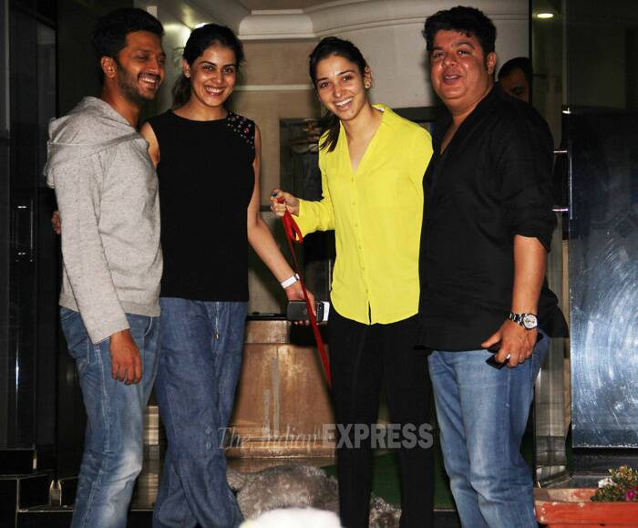 Bollywood actress Tamannaah Bhatia hosted a party for her 'Humshakals' co-stars and director Sajid Khan at her Mumbai residence on Saturday (June 21). <br /> While Saif Ali Khan, Ram Kapoor and Bipasha Basu gave the party a miss, dad-to-be Riteish Deshmukh came with his pregnant wife Genelia. (Source: Varinder Chawla)