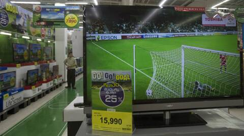 A Thai man watches a soccer match on a television at a shopping mall in Bangkok, Thailand. (AP)