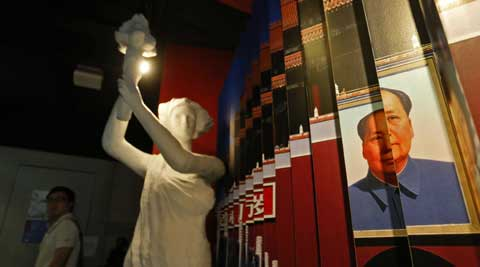 A statue of the Goddess of Democracy and a portrait of the late Communist leader Mao Zedong are displayed at the June 4th Museum in Hong Kong. (AP)