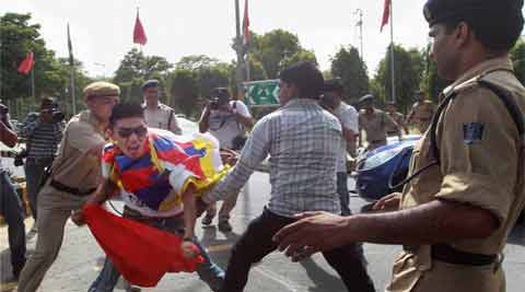 A Tibetan activist protests against the visit of Chinese Premier Li Keqiang outside the Chinese embassy in New Delhi. (Source: PTI)