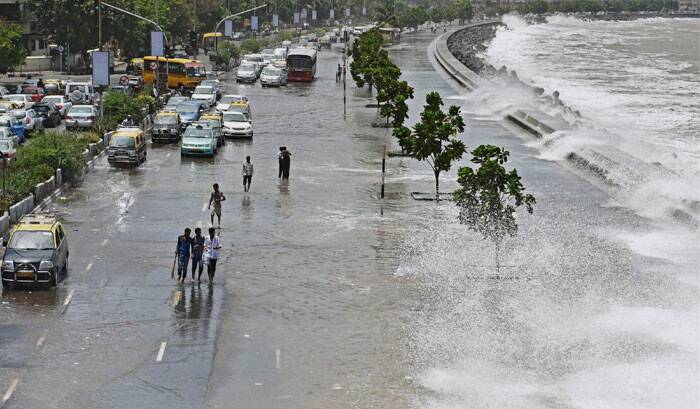 A high tide inundates Marine drive in Mumbai on Thursday. (Source: PTI)