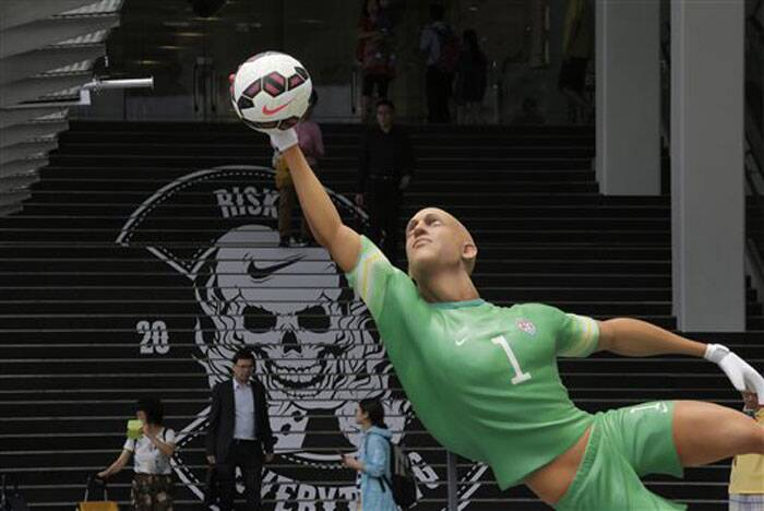 A giant size figure of the United States' goalkeeper Tim Howard is displayed outside a shopping mall in Hong Kong to promote the 2014 FIFA World Cup in Brazil. (Source: AP)