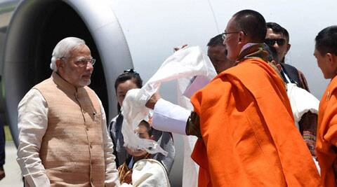 Prime Minister Narendra Modi being received by his Bhutanese counterpart Tshering Tobgay on his arrival at the Paro International Airport in Bhutan on Sunday. (Source: PTI)