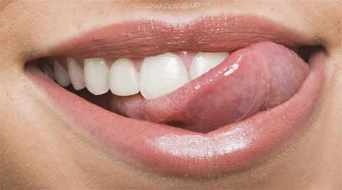 Why is it so rare to bite your own tongue while chewing food? Your brain holds the answer! (Source: Thinkstock)