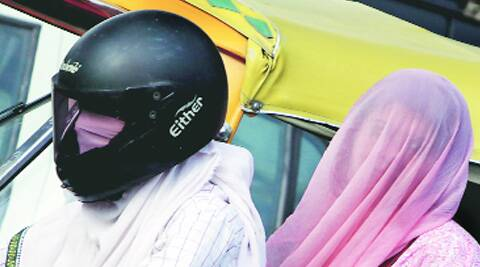 Most of those who stepped out on Monday preferred to keep their faces covered. (Source: Express photo by Amit Mehra)