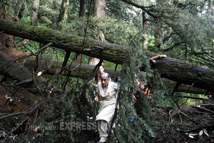 An old woman makes way through the wreckage at the accident site. (Source: Express photo by Lalit Kumar)