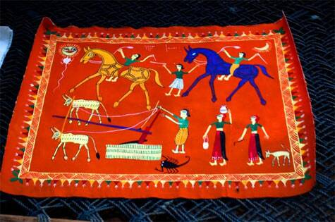 A village scene depicted in a Pithora painting on a cloth | Source: Swasti Pachauri