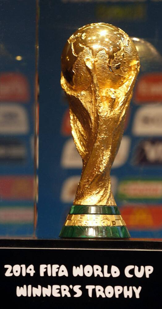 "The 32 teams will battle it out for this coveted gold trophy to be awarded to the winner. ""The authentic, one-of-a-kind FIFA World Cup Trophy is 36.8cm (14.5 inches) high, 6,175g (13.61 pounds) heavy, and made of 18-carat gold. The base contains two layers of semi-precious malachite while the bottom side of the Trophy bears the engraved year and name of each FIFA World Cup winner since 1974,"" clamed the official FIFA website. (Source: Reuters)"