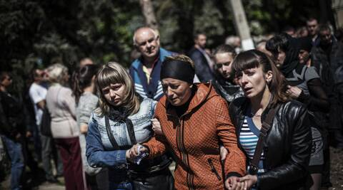 Relatives and friends of pro Russia gunmen killed in clashes with the Ukrainian army on Monday cry after the funeral of several pro Russia gunmen and a civilian in Slovyansk, Ukraine. (AP)