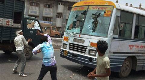 Locals damaging government buses in protest against the murder of two police constables in Firozabad district on Monday. (Source: PTI)