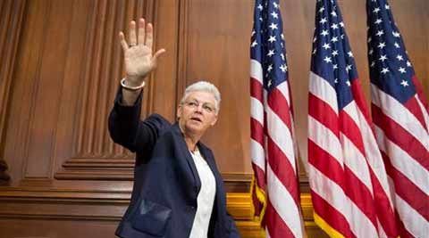 Environmental Protection Agency Administrator Gina McCarthy waves before signing new emission guidelines. (Source: AP)