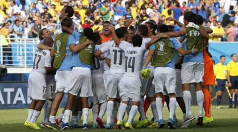 Uruguayan players celebrate their 1-0 win over Italy after which they qualified for the Round of 16. (Source: Reuters)