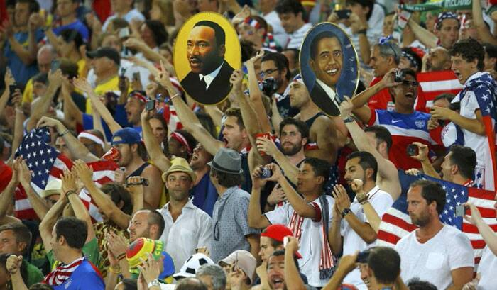 Great Icons: USA fans hold up posters of Martin Luther King Jr. and President Obama, seen during the game against Ghana. (Source: Reuters)