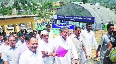 Chief Minister Harish Rawat and other MLAs come out of the assembly tent.