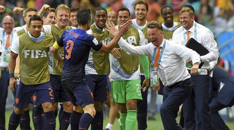Netherlands' Robin van Persie celebrates with Netherlands' head coach Louis van Gaal after scoring a goal during their World Cup opener against Spain. (Source: AP)