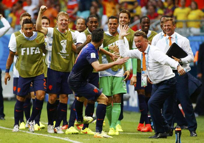 Robin van Persie celebrates his gorgeous goal against Spain with coach Louis van Gaal. (Source: Reuters)