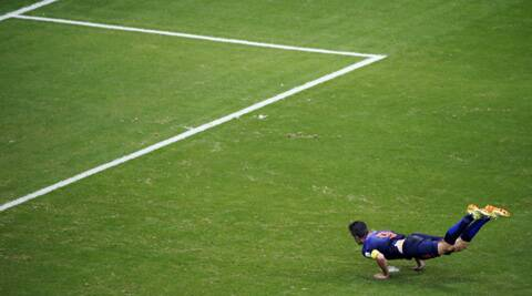 Van Persie goes airborne as he heads goalwards to make it 1-1. (Source: Reuters)
