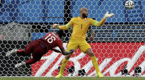 Portugal's Silvestre Varela heads the ball past United States' goalkeeper Tim Howard to score his side's second goal (Source: AP)