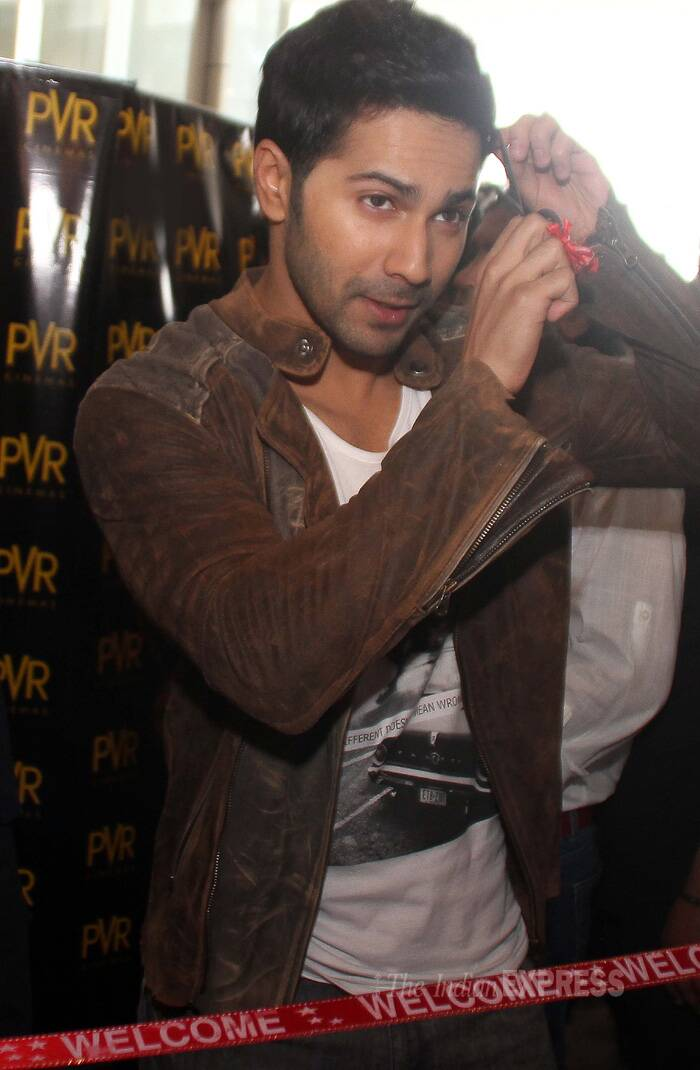Stop Varun!  The actor was up for some fun when he was handed the scissors to cut the ribbon. (Source: Express Photo by Gurmeet Singh)