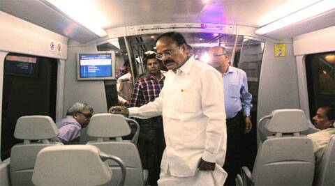 Union Minister M Venkaiah Naidu travels by the Airport Metro on Monday. During the journey, he interacted with commuters and took their suggestions on ways to improve the service.(Express photo by Prem Nath Pandey )