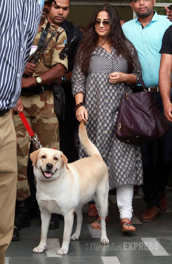 Vidya wore a printed kurti with chite churridar bottoms and carried a dark coloured handbag. (Source: Express Photo by Bhupendra Rana)
