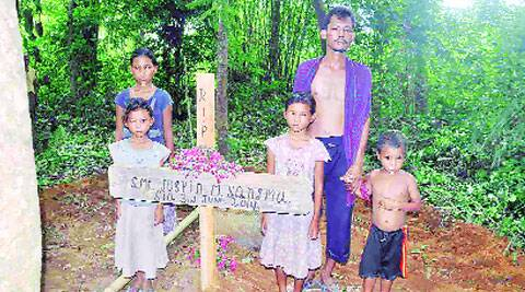 Jospin's husband and her four children at her burial site at Duragre  village in Meghalaya Thursday. DASARATH DEKA