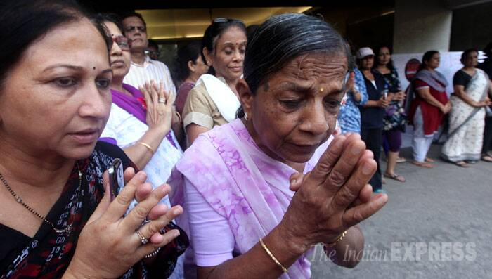 In this file photo residents of Campa Cola are seen praying at the compound after the final notice was served from Bombay Municipal Corporation to evacuate flats at Campa Cola in Mumbai. (Source: Express Photo by Prashant Nadkar)